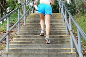stair climbing back of woman climbing stairs 300x199 The best aerobic exercise for weight loss